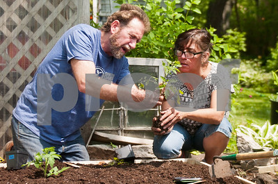 Ted Lowe talks to Ayda Meza about planting during Saturday Garden Works Project. David Toney for Shaw Media