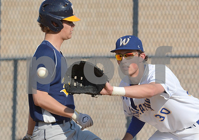 Wheaton North first baseman Andrew Nelson takes the throw from the pitcher during their game against Nequa Valley Friday May 6 in Wheaton. Mark Busch - mbusch@shawmedia.com