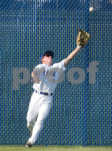 Wheaton North outfielder Ryan Muehfelt reaches up and makes the catch of a deep flyball during their game against Nequa Valley Friday May 6 in Wheaton. Mark Busch - mbusch@shawmedia.com