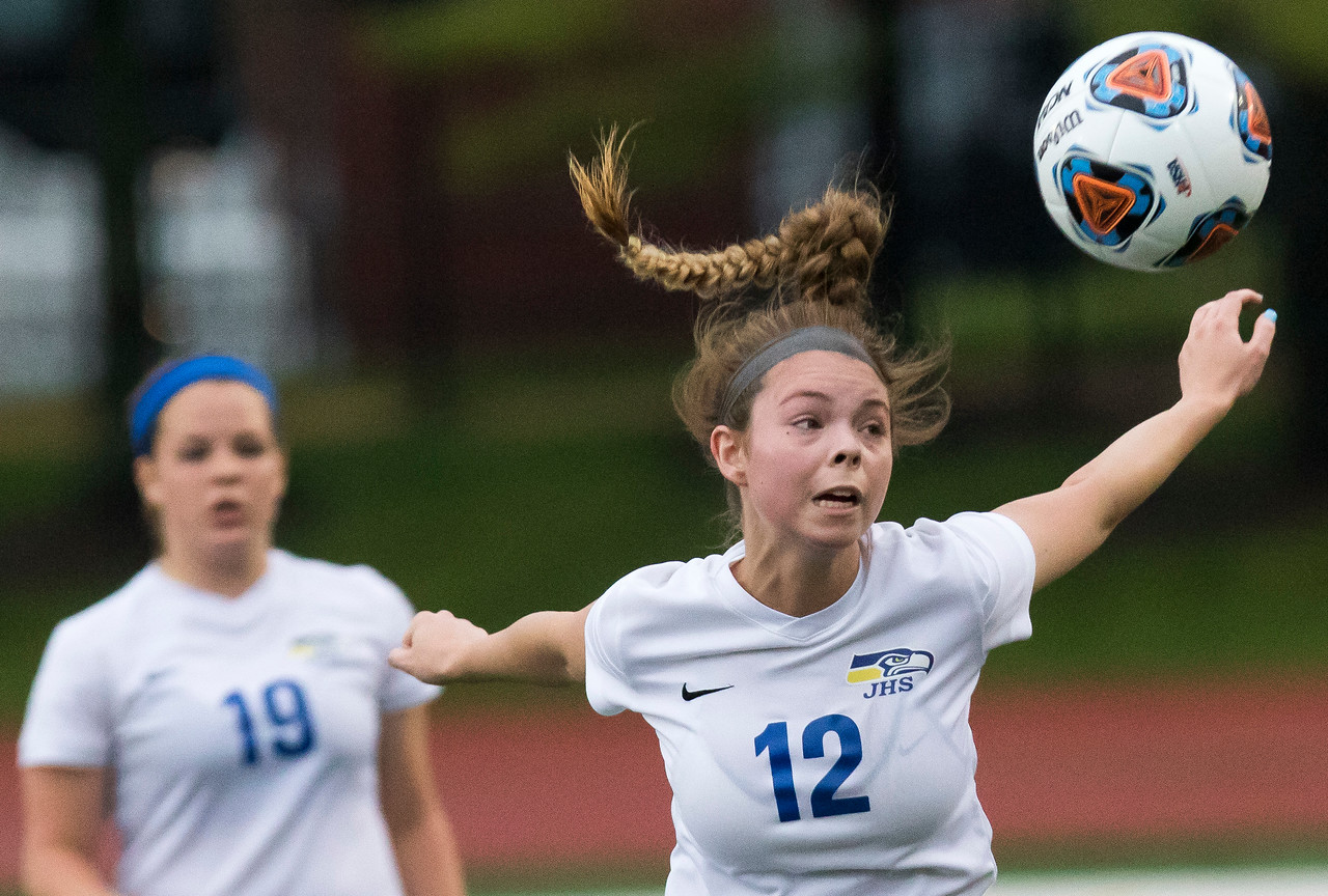 Sarah Nader - snader@shawmedia.com Johnsburg's Corin Cameron heads the ball during the second half of Friday's 1A state semifinal game against University High School May 26, 2017 at North Central College in Naperville. Johnsburg lost 3-2.