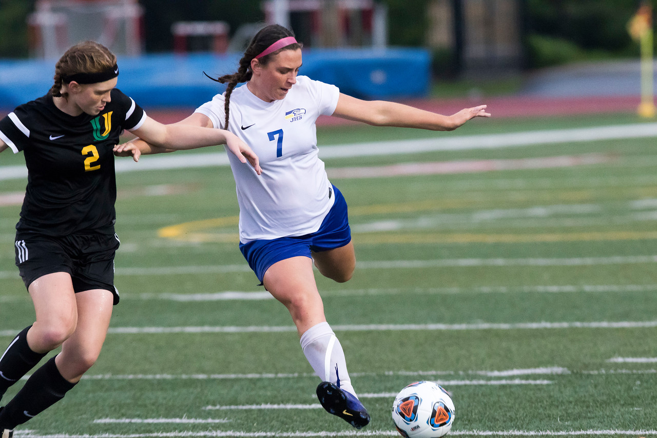 Sarah Nader - snader@shawmedia.com University's Elise Crockett (left) chases after Johnsburg's Shae Giovanni while she kicks the ball towards the goal during the second half of Friday's 1A state semifinal game  May 26, 2017 at North Central College in Naperville. Johnsburg lost 3-2.