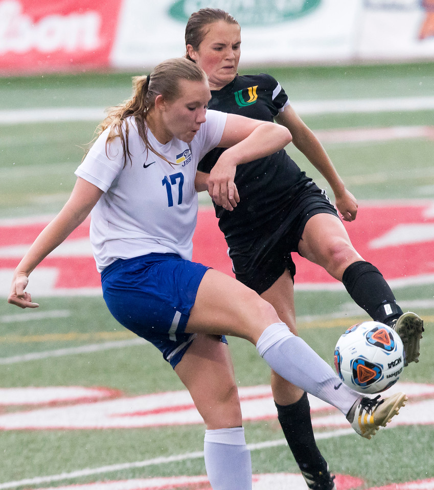 Sarah Nader - snader@shawmedia.com Johnsburg's Megan Jurek (left) tries to kick the ball past  University''s Julia Herrman during the second half of Friday's 1A state semifinal game May 26, 2017 at North Central College in Naperville. Johnsburg lost 3-2.