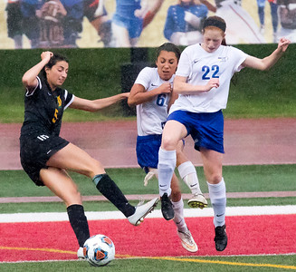 Sarah Nader - snader@shawmedia.com University's Sarah LaFayette (left) Johnsburg's Alivia Siudak (left) Kaitlyn Owen try to stop the ball during the first half of Friday's 1A state semifinal game May 26, 2017 at North Central College in Naperville. Johnsburg lost 3-2.