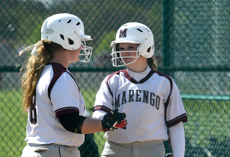 Kayla Wolf for Shaw Media- Marengo teammates, from left, Emily Atchison and Anna Walsweer. Marengo won 13 to 1 over Bartlett.