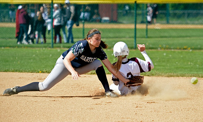 Kayla Wolf for Shaw Media- Bartlett junior Amber Pagan misses the throw to tag out Marengo senior Rachel Jasinski Saturday, May 6, 2017, as she steals second base. Marengo won 13 to 1.