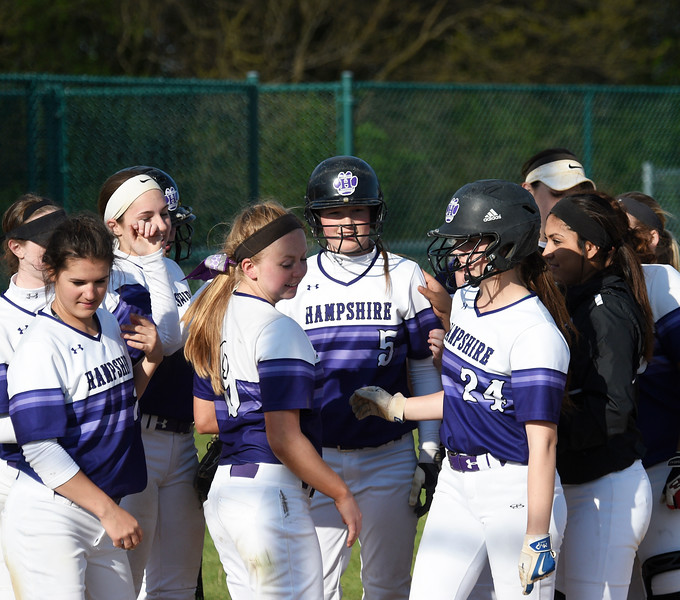 Kayla Wolf for Shaw Media- Hampshire sophomore Sarah Bowen,5, walks off the field after being embraces by her teammates Saturday, May 6, 2017, after hitting a homer. Hampshire lost to Bishop McNamara 6 to 2.