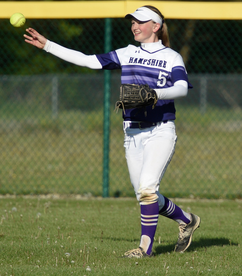Kayla Wolf for Shaw Media- Hampshire sophomore Sarah Bowen throws a ball into the infield Saturday, May 6, 2017, during a tournament held at Marengo High School. Hampshire had won the previous two games it played in the tournament.