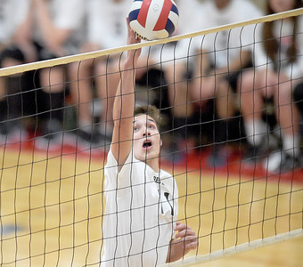 Kayla Wolf for Shaw Media - Huntley junior Charlie Johnson gets the ball over the net during a home game Monday May 1, 2017, against Harlem. Huntley lost two of three sets.