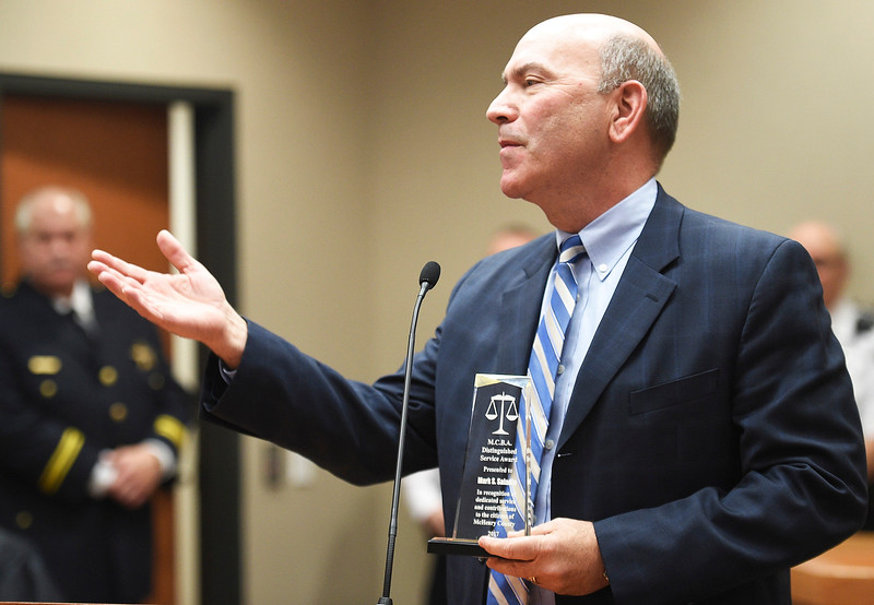 Kayla Wolf for Shaw Media- Attorney Mark Saladin thanks family and colleagues Friday, May 5, 2017, for the Distinguished Service Award he received as part of Law Day at the McHenry County Courthouse. Saladin serves on the Woodstock City council and volunteers in many aspects of the community.