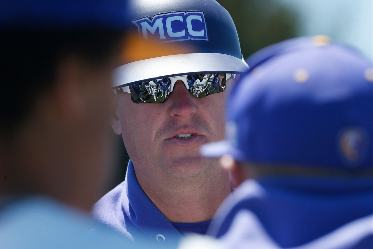 McHenry County College head coach Jared Wacker talks with his team between innings of their game against Carl Sandburg College at McHenry County College on Sunday, May 7, 2017 in Crystal Lake, Ill. The Scots won the game 5-2. | John Konstantaras photo for the Northwest Herald