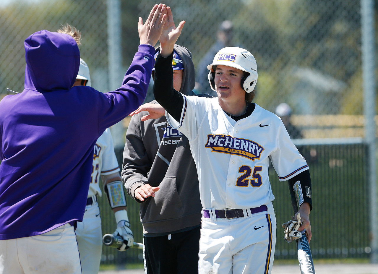Tyler Stamer (25) of MCC heads to the bench after scoring during the second inning of their game against Carl Sandburg College at McHenry County College on Sunday, May 7, 2017 in Crystal Lake, Ill. The Scots won the game 5-2. | John Konstantaras photo for the Northwest Herald