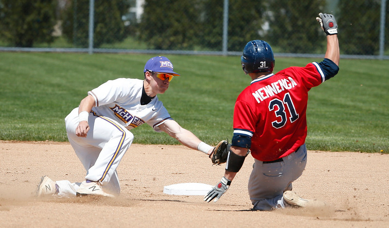 Nick Vasic (10) of MCC tags out Marty Mennenga (31) of Carl Sandburg College on a steal attempt during the first inning of their game at McHenry County College on Sunday, May 7, 2017 in Crystal Lake, Ill. The Scots won the game 5-2. | John Konstantaras photo for the Northwest Herald