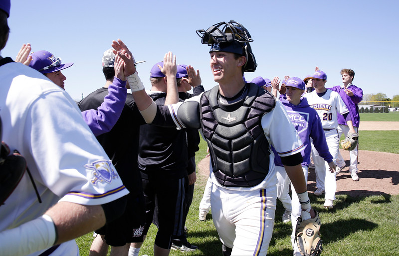 Wyatt Mascarella (21) of MCC and his teammates celebrate their win over Carl Sandburg College at McHenry County College on Sunday, May 7, 2017 in Crystal Lake, Ill. The Scots won the game 5-2. | John Konstantaras photo for the Northwest Herald