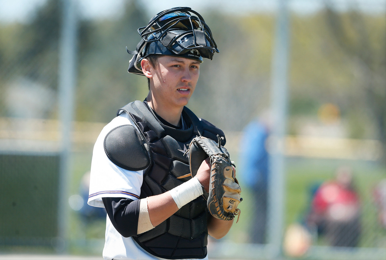 Catcher Wyatt Mascarella (21) of MCC during their game against Carl Sandburg College at McHenry County College on Sunday, May 7, 2017 in Crystal Lake, Ill. The Scots won the game 5-2.   John Konstantaras photo for the Northwest Herald
