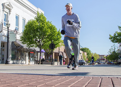 Ken Koontz – For Shaw Media Mark Oefelein of Huntley nears the finish line of the 20th annual Bob Blazier Run for the Arts 5K Run and Walk on Sunday May 7 in Crystal Lake. Oefelein finished in second place in his age group.