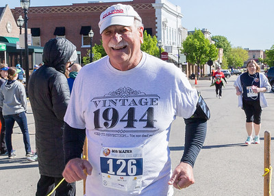 Ken Koontz – For Shaw Media Runner Donald Calgano crosses the finish line at the 20th annual Bob Blazier Run for the Arts 5K Run and Walk on May 7 in Crystal Lake.