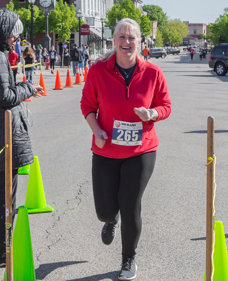 Ken Koontz – For Shaw Media Melissa McConnell comes to the finish line during the 20th annual Bob Blazier Run for the Arts 5K Run and Walk on May 7 in Crystal Lake.