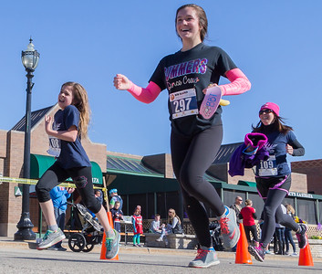 Ken Koontz – For Shaw Media Runners Chloe Atkinson, (from left) Madelyn Coles, and Jennifer Atkinson complete the 20th annual Bob Blazier Run for the Arts 5K Run and Walk on Sunday May 7 in Crystal Lake.