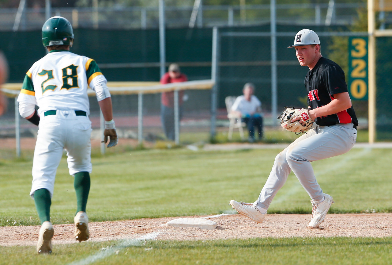 Third baseman Jeffrey Heinrich (16) from Huntley forces out Scott Skwarek (28) from Crystal Lake South for a double play after catching a line drive off the bat of Ryan Parquette (not pictured) during the third inning of their game at Crystal Lake South on Monday, May 15, 2017 in Crystal Lake. The Red Raiders won the game 2-0. | John Konstantaras photo for the Northwest Herald