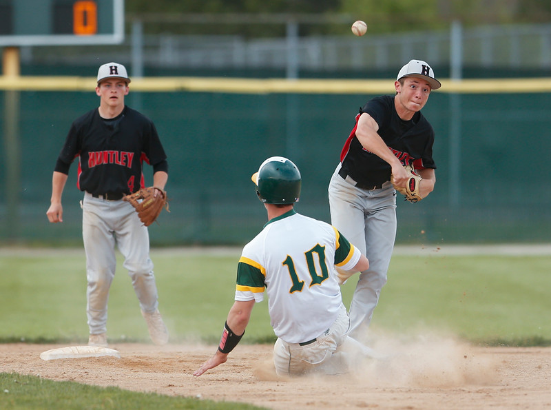 Jordan Goldstein (10) from Huntley throws over Noah Tyrrell (10) from Crystal Lake South for a double play during the fourth inning of their game against Crystal Lake South on Monday, May 15, 2017 in Crystal Lake. The Red Raiders won the game 2-0. | John Konstantaras photo for the Northwest Herald