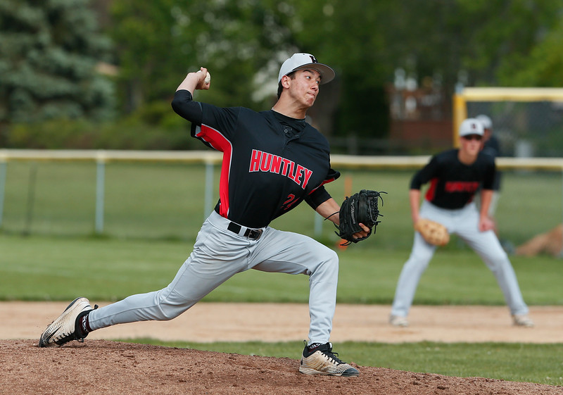Nicholas Laxner (24) from Huntley de;livers a pitch during their game against Crystal Lake South on Monday, May 15, 2017 in Crystal Lake. The Red Raiders won the game 2-0. | John Konstantaras photo for the Northwest Herald