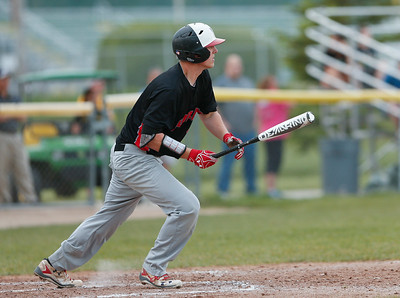 Noah Konie (25) from Huntley hits an RBI single during the fifth inning of their game against Crystal Lake South on Monday, May 15, 2017 in Crystal Lake. The Red Raiders won the game 2-0. | John Konstantaras photo for the Northwest Herald