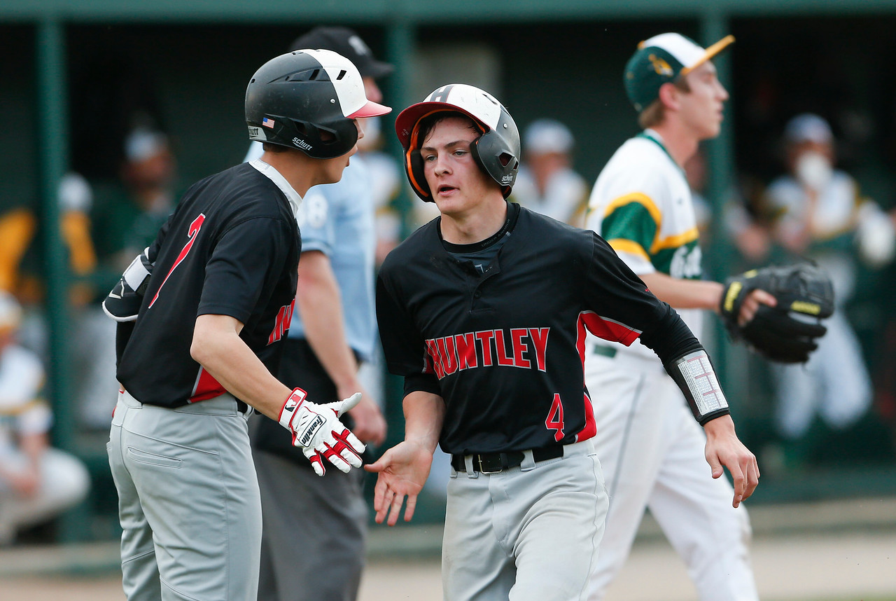 Joe Boland (4) from Huntley scores on a RBI single by Noah Konie (not pictured) during the fifth inning of their game against Crystal Lake South on Monday, May 15, 2017 in Crystal Lake. The Red Raiders won the game 2-0. | John Konstantaras photo for the Northwest Herald