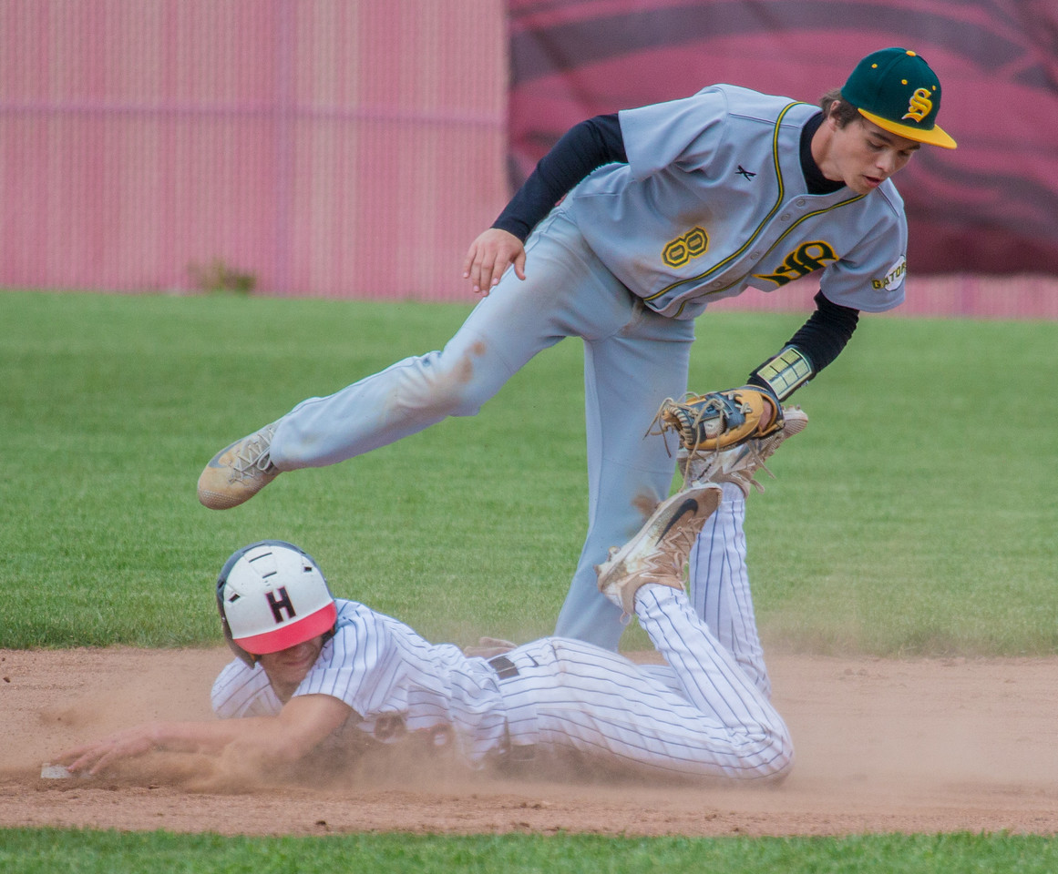 Huntley's Tyler Koss is tagged out trying to steal second by Crystal Lake South's Kory Olsen (8) Saturday, May 13, 2017 at Huntley High School. Huntley wins in extra innings 2-1. KKoontz – for Shaw Media