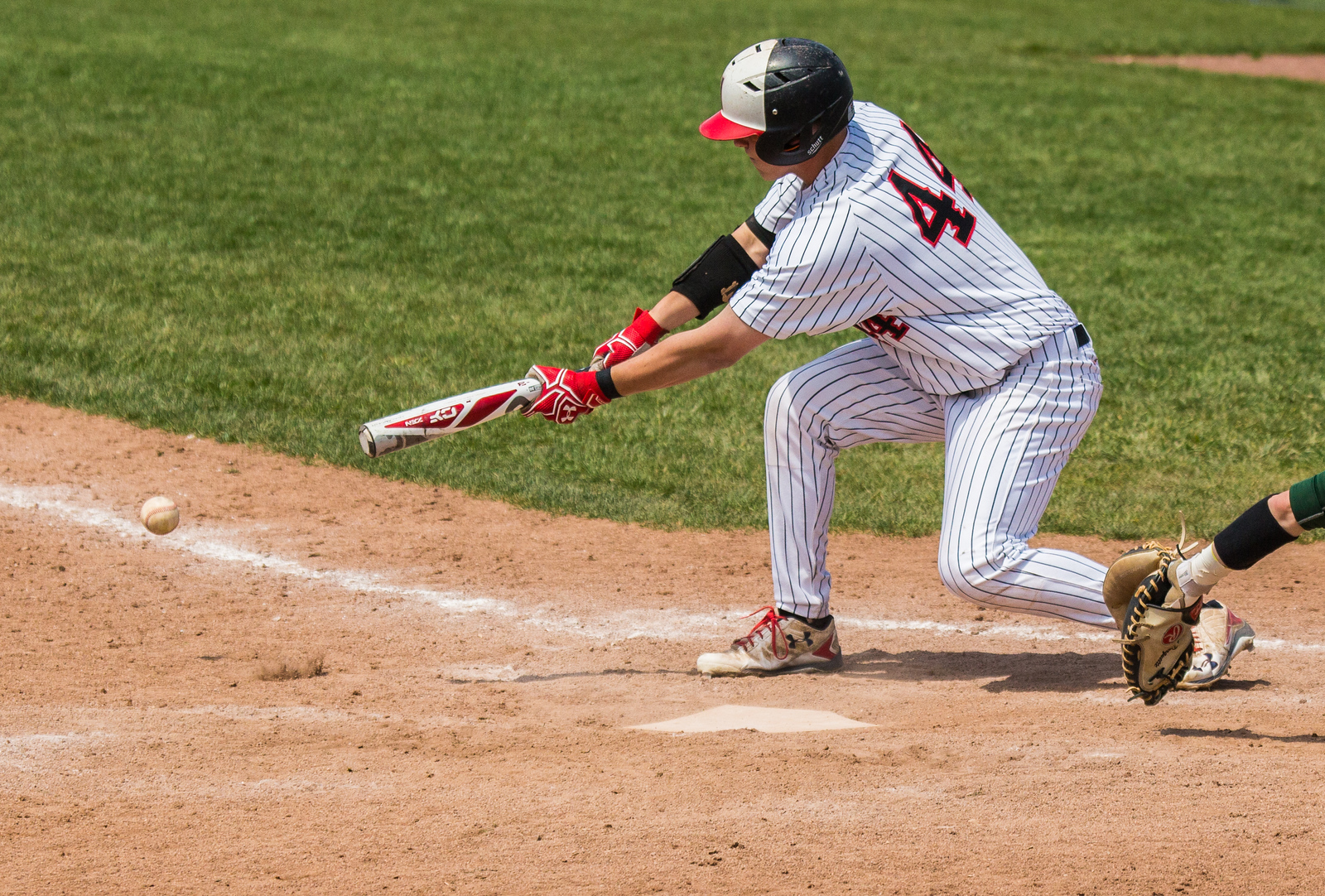 Huntley's Noah Konie lays down a sacrifice bunt in the eighth inning against Crystal Lake South Saturday, May 13, 2017 at Huntley High School. Huntley went on to win in walk-off fashion 2-1. KKoontz – for Shaw Media