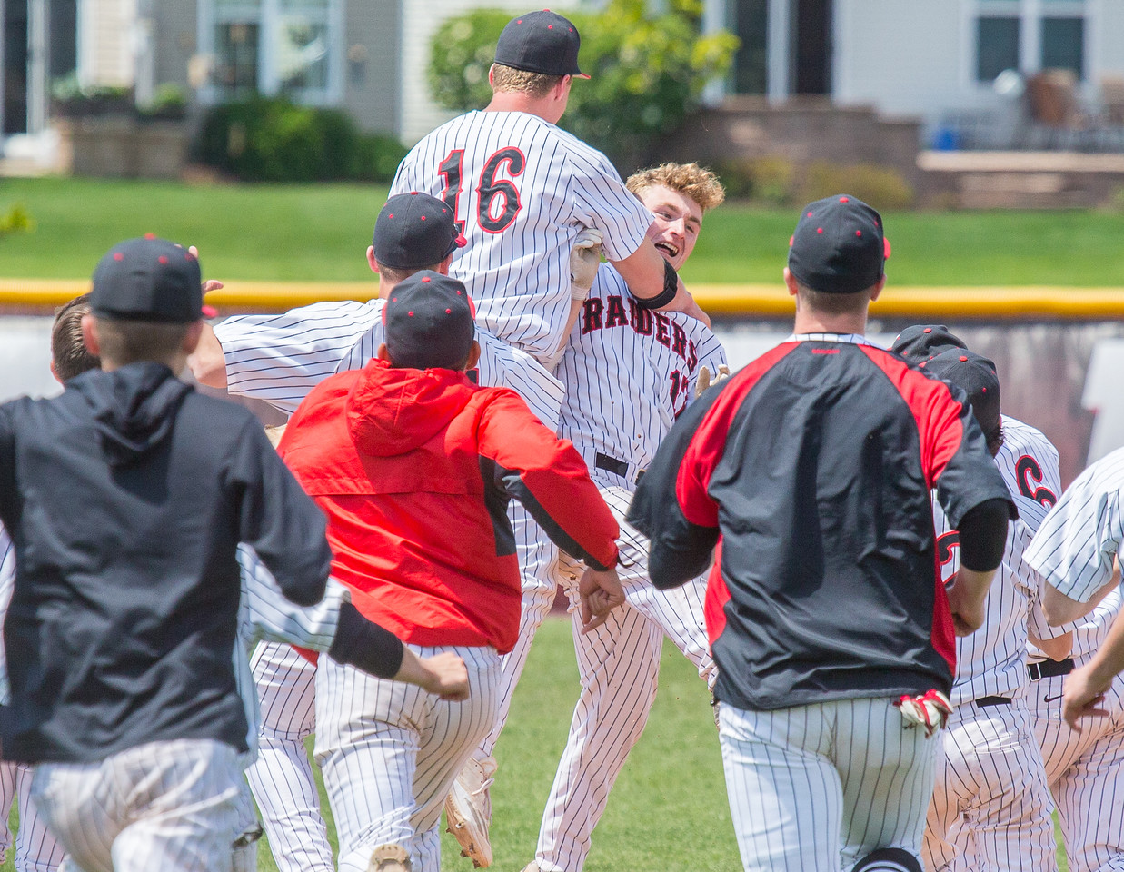 Huntley team members celebrate Joe Rizzo's two out walk-off single driving in teammate Christopher Costantino for the win over Crystal Lake South by the score of 2-1. The game was held at Huntley High School Saturday, May 13, 2017. KKoontz – for Shaw Media