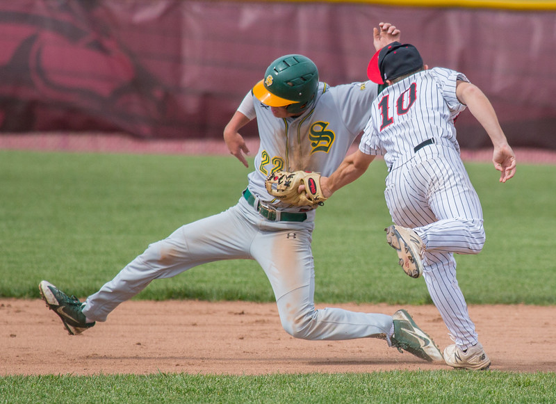 Huntley's Jordan Goldstein (10) tags Crystal Lake South's Michael Swiatly (22) out at second Saturday, May 13, 2017 at Huntley High School. Huntley wins in extra innings 2-1. KKoontz – for Shaw Media