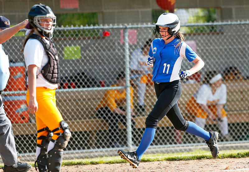 Natalie Hansen (11) from Woodstock scores during the third inning of their game against Richmond-Burton on Thursday, May 18, 2017 in Richmond. The Rockets defeated the Blue Streaks 12-2 in 5 innings. John Konstantaras photo for the Northwest Herald
