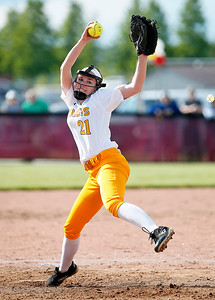 Rachel Hayden (21) from Richmond-Burton delivers a pitch during the first inning of their game against Woodstock at Richmond-Burton High School on Thursday, May 18, 2017 in Richmond. The Rockets defeated the Blue Streaks 12-2 in 5 innings. John Konstantaras photo for the Northwest Herald