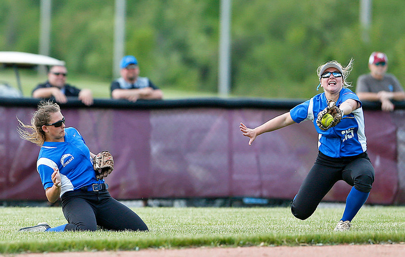Michelle Hanson (16) from Woodstock watches as Taylor Spanbauer (right) catches a ball hit by Rachel Hayden (not pictured) from Richmond-Burton to end the third inning of their game against  Richmond-Burton on Thursday, May 18, 2017 in Richmond. The Rockets defeated the Blue Streaks 12-2 in 5 innings. John Konstantaras photo for the Northwest Herald