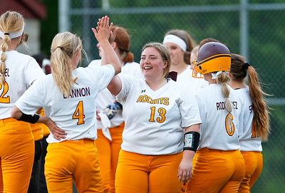 Haylie Regnier (13) from Richmond-Burton high fives Peyton Bannon (4) after their game against Woodstock at Richmond-Burton High School on Thursday, May 18, 2017 in Richmond. The Rockets defeated the Blue Streaks 12-2 in 5 innings. John Konstantaras photo for the Northwest Herald