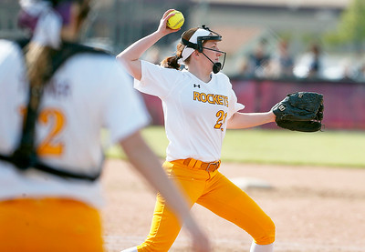 Pitcher Rachel Hayden (21) from Richmond-Burton throws out Abby Primus (not pictured) from Woodstock during the first inning of their game at Richmond-Burton High School on Thursday, May 18, 2017 in Richmond. The Rockets defeated the Blue Streaks 12-2 in 5 innings. John Konstantaras photo for the Northwest Herald