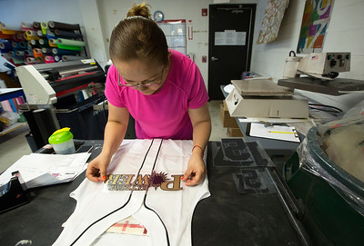 John Konstantaras - For Shaw Media Maria P. Rodriguez, of Harvard, sets a venal transfer on a jersey at Sport Decals on Thursday, May 18, 2017 in Spring Grove. Paul Metivier, Chris Gagnon and Don Metivier have recently re-acquired the company serves more than 10,000 high schools, colleges, clubs and organizations through the sale of custom team uniforms, spirit wear and decals.