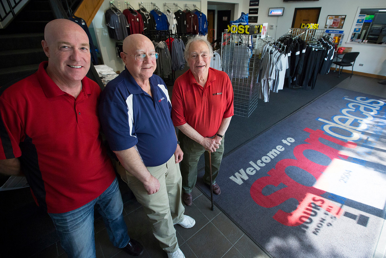 John Konstantaras - For Shaw Media Sport Decals co-owners Chris Gagnon, (from left) Paul Metivier and Don Metivier have at Sport Decals on Thursday, May 18, 2017 in Spring Grove. Don Metivier founded the company 50 years ago and they have recently re-acquired the company that serves more than 10,000 high schools, colleges, clubs and organizations through the sale of custom team uniforms, spirit wear and decals.