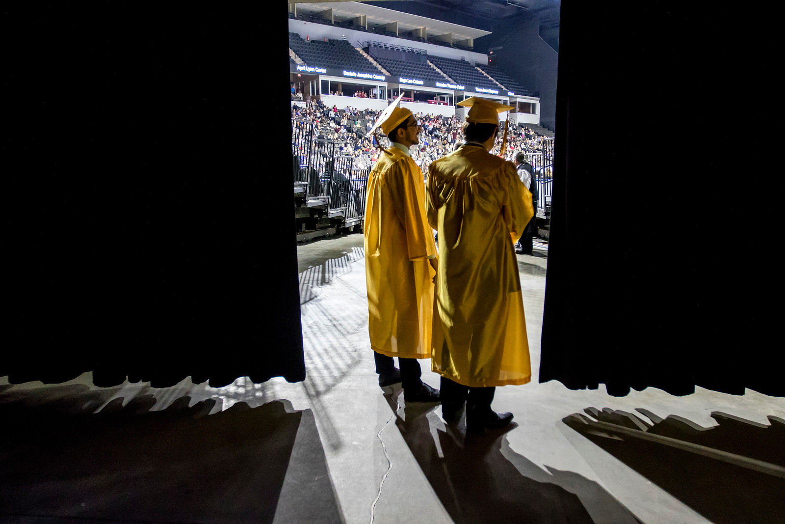 Sarah Nader - snader@shawmedia.com Tamur Baig (left) and Andrew Benson takes a peak at the arena before the Harry D. Jacobs High School 2017 Commencement at the Sears Center Arena in Hoffman Estates Saturday, May 20, 2017.