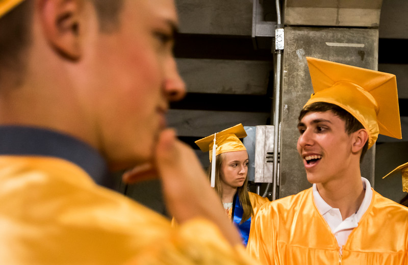 Sarah Nader - snader@shawmedia.com Cirrus Lingl (center) of Algonquin waits in line before the Harry D. Jacobs High School 2017 Commencement at the Sears Center Arena in Hoffman Estates Saturday, May 20, 2017.