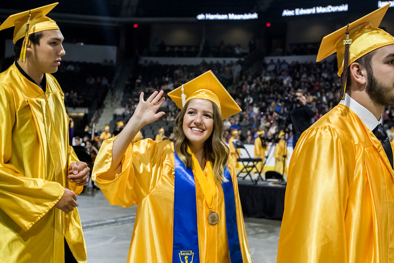 Sarah Nader - snader@shawmedia.com Jessica Kuhns waves at family members in the crowd during the Harry D. Jacobs High School 2017 Commencement at the Sears Center Arena in Hoffman Estates Saturday, May 20, 2017.