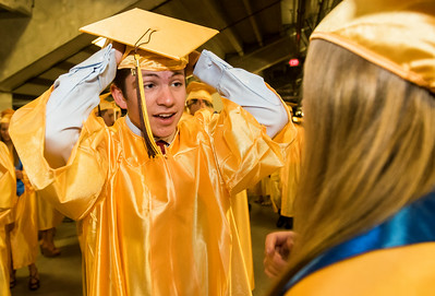 Sarah Nader - snader@shawmedia.com Jackson Wilken puts his cap on before the Harry D. Jacobs High School 2017 Commencement at the Sears Center Arena in Hoffman Estates Saturday, May 20, 2017.