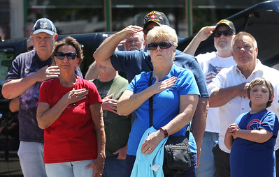 Candace H. Johnson-For Shaw Media A group of people watch the American flag being raised during the Fox Lake Memorial Day Celebration at the Fox Lake Train Station.