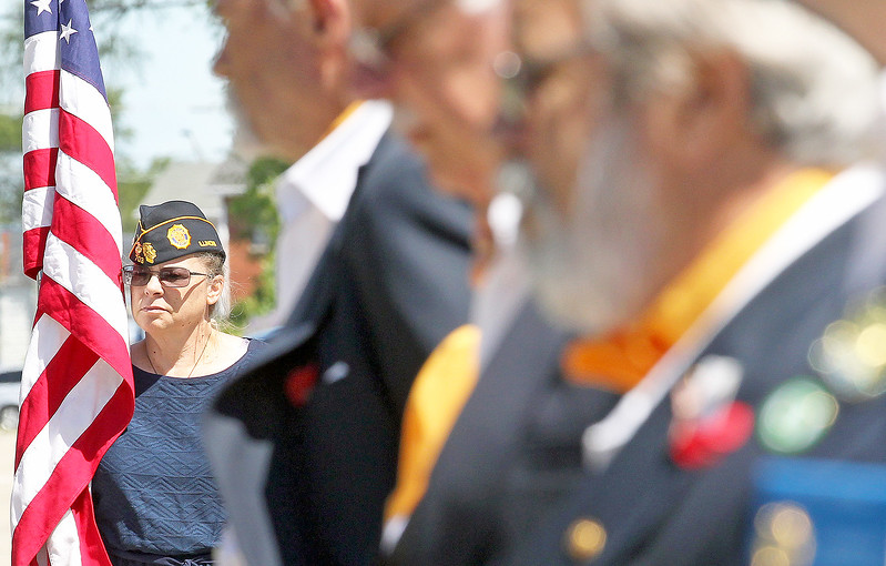 Candace H. Johnson-For Shaw Media Sandra Fedderly, of Kenosha, Wis., holds the American flag during the Fox Lake Memorial Day Celebration at the Fox Lake Train Station. Fedderly is a Marine and Army veteran.