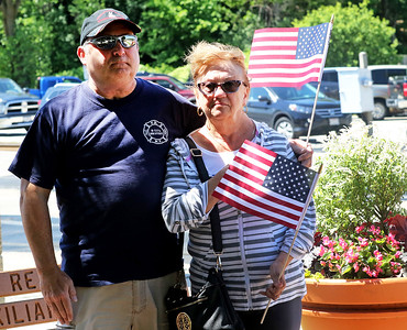 Candace H. Johnson-For Shaw Media Tim and Ellen Damato, of Lake Villa listen to the speakers during the Fox Lake Memorial Day Celebration at the Fox Lake Train Station.
