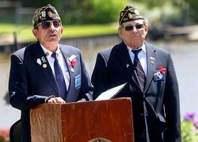 Candace H. Johnson-For Shaw Media Commander Robert R. Gabriel, of Antioch and Jerry Kandziorski, of Spring Grove, chaplain, with Post 703 address the crowd during the Fox Lake Memorial Day Celebration at the American Legion in Fox Lake.