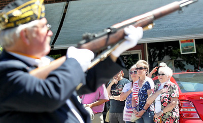 Candace H. Johnson-For Shaw Media Pam Renaker, Sharon Burr and Marguerite Drozd, all of Fox Lake watch the Rifle Guard with American Legion Post 703 during the Fox Lake Memorial Day Celebration at the Fox Lake Train Station.