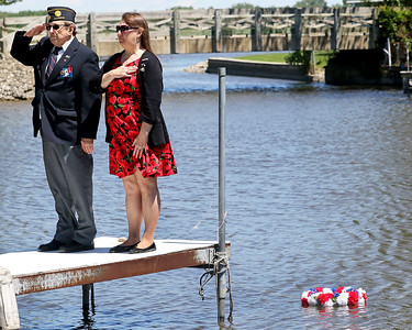 Candace H. Johnson-For Shaw Media Jerry Kandziorski, of Spring Grove, chaplain, and Virginia Johnson, of Twin Lakes, Wis., stand on a pier close to the memorial wreath they put in the water to commemorate soldiers who lost their lives at sea during the Fox Lake Memorial Day Celebration at the American Legion in Fox Lake.