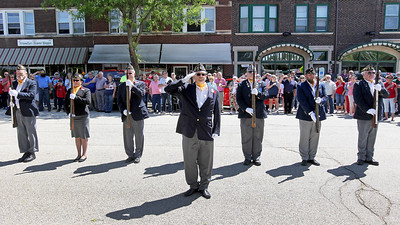 Candace H. Johnson-For Shaw Media Sergeant at Arms Jim Locke, of Ingleside (center) stands at attention with the Rifle Squad from American Legion Post 703 during the Fox Lake Memorial Day Celebration at the Fox Lake Train Station. Locke is an Army veteran.