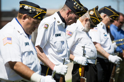 William Cheatham, second from left with American Legion Post 491, bows his head with members of the color guard as Chaplin Kenneth Hauser, not pictured, reads the benediction during the Memorial Day ceremony at Veterans Memorial Park on Monday, May 29, 2017 in McHenry. John Konstantaras photo for the Northwest Herald